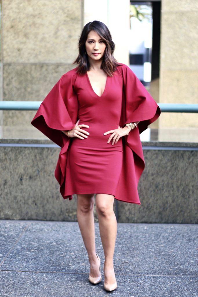 Diane Mizota in red batwing dress