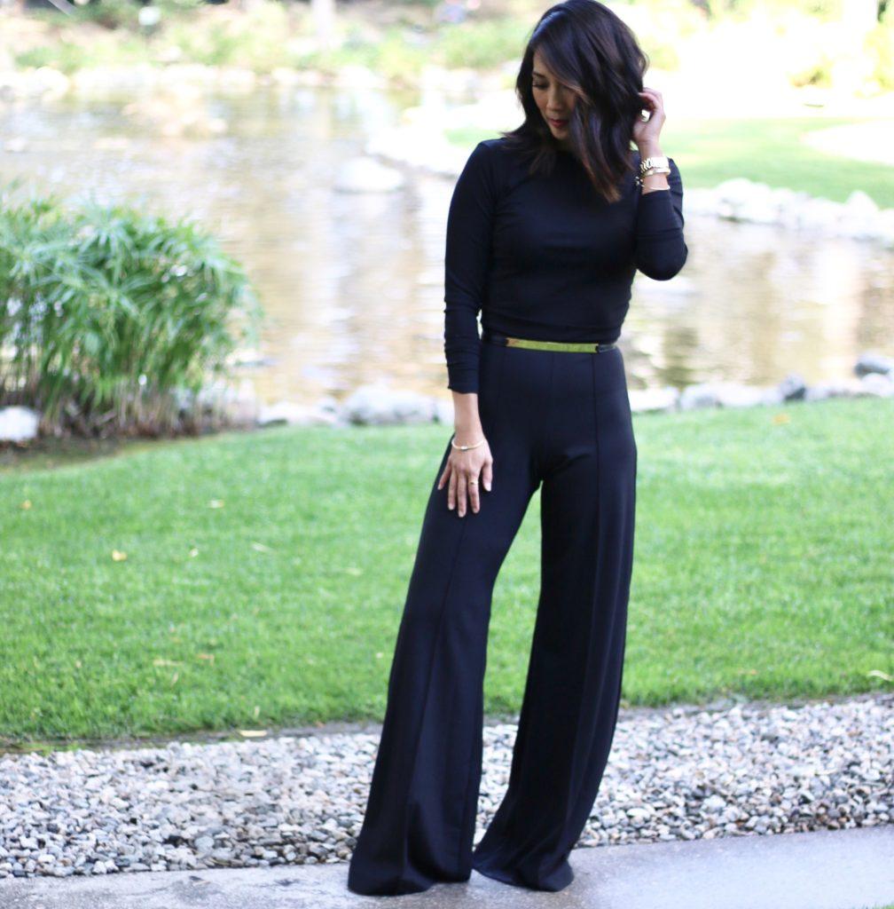 Front view Diane Mizota wearing a black wide-leg catsuit